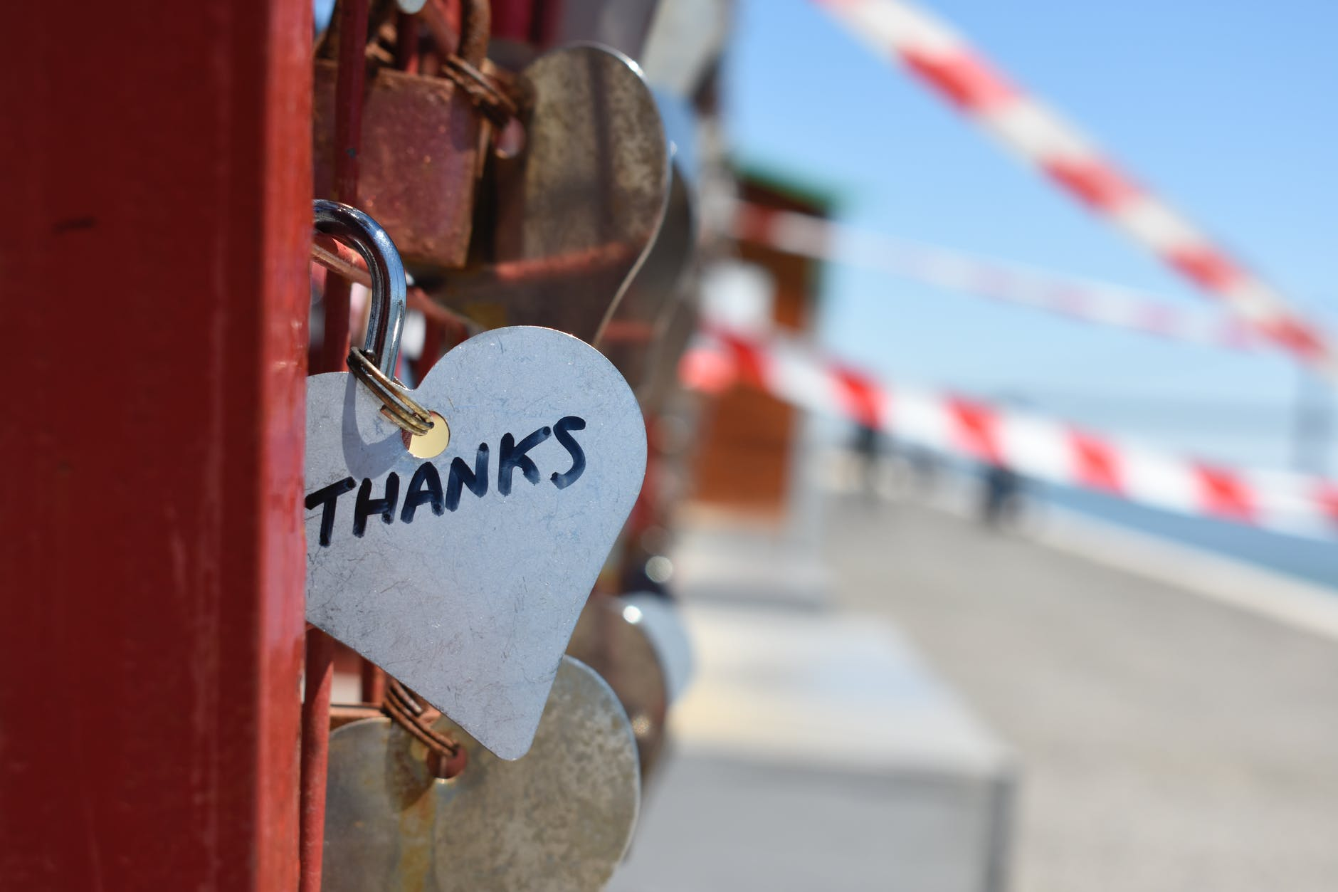 """Thanks"" lock on a fence"